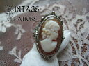A delicate antique classic reprint design / cameo & Onyx reversible ring (Oval) 48