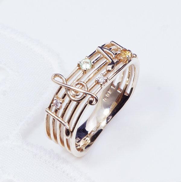 ギフトおすすめ10金ダイヤ ト音記号 デザインリング 31-9237ペリドット シトリン モダンなドレッシーなデザイン。音楽好きの方にはたまらない素敵なリング。大切な方や自分へのプレゼントにもおすす!