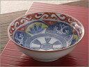 古い文様を写し斬新な色使いの小鉢で、使い勝手の良い深さです。京焼