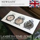 LAMBETHTIMEZONE(ランベスタイムゾーン) ウォールクロック 掛け時計 アンティーク時計を見事にアレンジしたレトロ感漂うクロックを展開する英国ブランドNEW GATE(ニューゲート)のLAMBETHTIMEZONE(ランベスタイムゾーン)はビンテージテイストの置時計が3つ並んで描かれた個性的なデザインで、存在感・インパクトともに抜群のウォールクロックです。3か国の時間が一目で分かる使い勝手も魅力的な掛け時計なので、リビングやダイニング、寝室や書斎などの壁面をおしゃれに演出したい方にはおすすめです。見やすい針と文字盤なので使用感も抜群です。 NEW GATE ビンテージ感&ダメージ感を再現し、アンティーク時計ならではのレトロな雰囲気を醸し出すクロックを展開する英国ブランドです。 ビンテージ感&ダメージ感が魅力のオリジナルティあふれる時計を展開するイギリスブランドNEWGATE(ニューゲート)のLAMBETHTIMEZONE(ランベスタイムゾーン)はデザインの異なる置時計が描かれており、3か国の時間を一目で見ることができる掛時計です。置時計を描いた掛け時計という他にはない個性的なデザインなど、随所にデザイナーの個性とこだわりを感じさせます。クラッシックでレトロな雰囲気漂うこだわりのデザインはヴィンテージテイストのインテリアや北欧モダン、カジュアルモダンデイストのお部屋など、幅広いシーンで活用できます。 サイズ W600×D44×H300 mm 材質 ウッド 納期 5日から10日程度 送料 送料無料 ※北海道・沖縄を除く