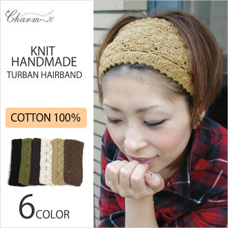 The Handmade Knitted hairband from charm - made from 100% cotton into a floral motif design.