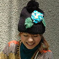 A soft knit bright flower is a mark! It is capped corsage knit softly girly knit hat ◆ with a big bonbon