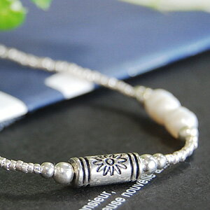 The breath that a motif and the fresh water pearl such as the pipe of the sunflower pattern made of the silver are cute! Brightness of the rainbow color such as the shell is wonderful! ◆Pearl beads bracelet [sunflower flowerpot ]《 outlet article 》]