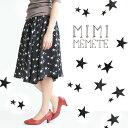 白黒 カラーでデザインされた、 お星様 スカート 。トレンドの ミモレ丈 にたっぷり Aライン の甘めシルエット。