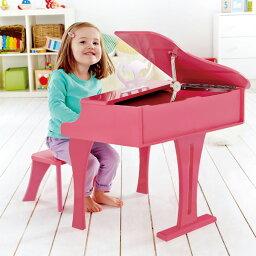 Hape ハペ ハッピーグランドピアノ ピンク〜ドイツのおもちゃメーカーHape(ハペ)の楽器玩具。グランドピアノ型のトイピアノです。