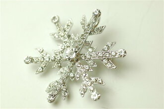 Swarovski stone brooches and snow crystals