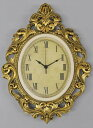 An Oval type wall clock: Antique gold