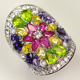 The ♪ flower design wide ring which CZ of the multicolored of high quality glistens with