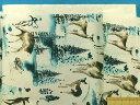綿プリント生地シカとハリネズミオフ白×ブルーグリン