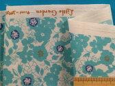綿ポリプリント生地(やや厚)花・オフ白×渋水