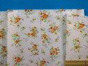 綿プリント生地(やや厚)小花・オフ白×オレンジ(115cm幅 2m)