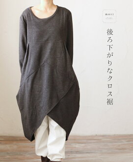 "□ □ a (solid charcoal grey) ""mori"" behind the fall cross-hem dress"