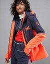 е╪еъб╝е╧еєе╗еє еье╟егб╝е╣ е╕еуе▒е├е╚бже╓еые╛еє евеже┐б╝ Helly Hansen Freedom Jacket in Navy/Orange Neon coral
