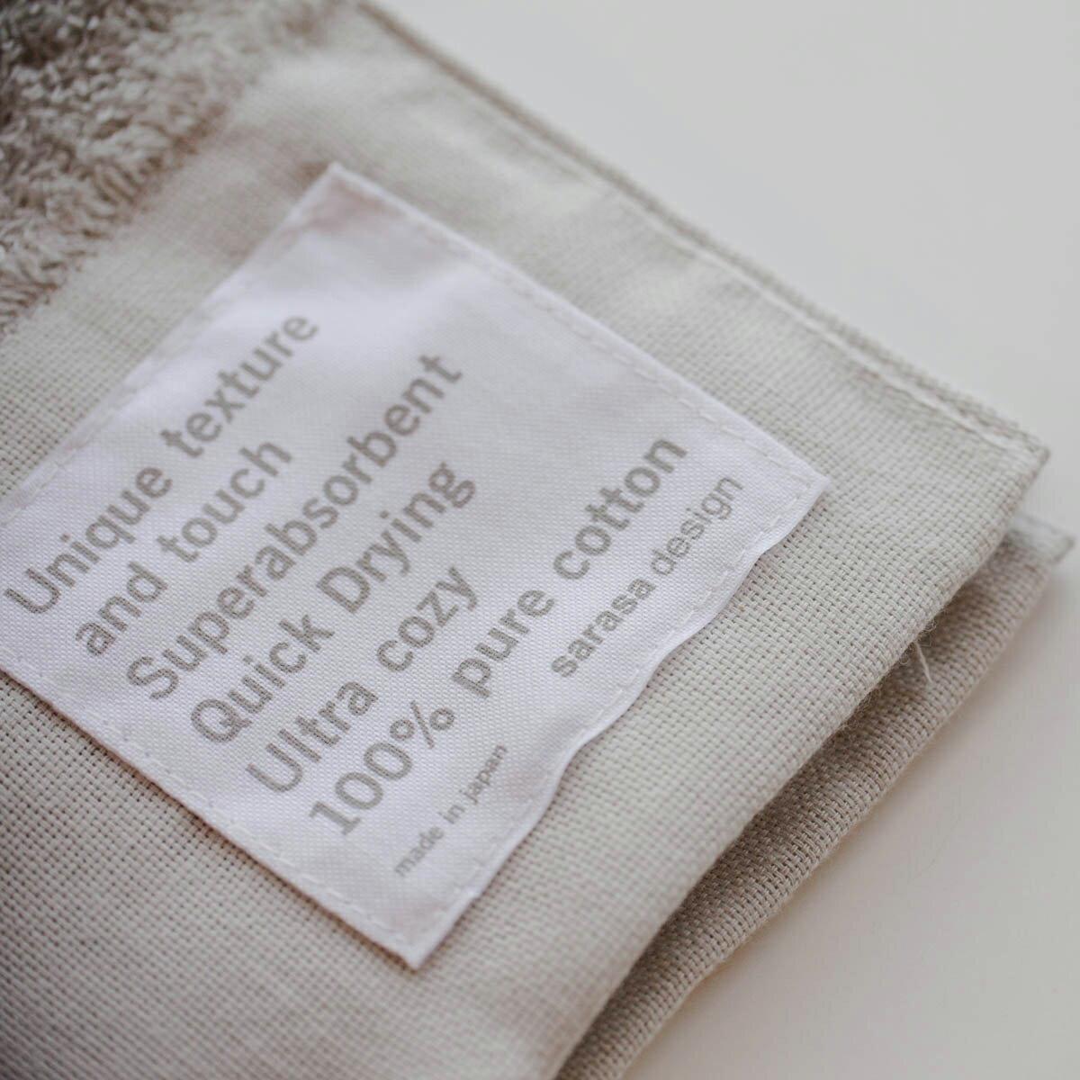 大阪泉州産の大きなヘムのデザインが特徴の吸水・速乾性に優れた、肌に優しい安心安全なオリジナル・バスタオル