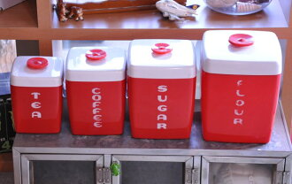 Old vintage canister set made in USA with a plastic canister set Made in USA