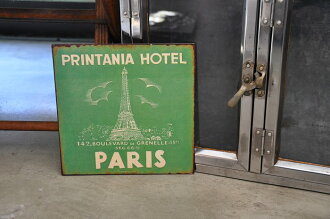 Metal signboard Eiffel Tower Paris of an old texture