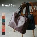 バッグ 使いやすさにこだわった、毎日の通勤・通学に頼れるバッグ。多収納ポケットトートバッグレディース/鞄/フェイクレザー/合皮/バイカラー/シンプル/エディターズバッグ