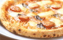 It is a pizza not a pizza! Real stone kiln pizza &quot;&quot; which a pizza craftsman burns