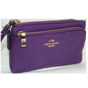 【中古】本物新品未使用品コーチ女性用綺麗な紫色収納部分が2箇所のハンドポーチ 持ち手の長さ最長33cm