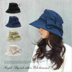 顔周りをしっかりカバーするつば広デザインだからUV対策帽子として最適!大きなサイドリボンが...