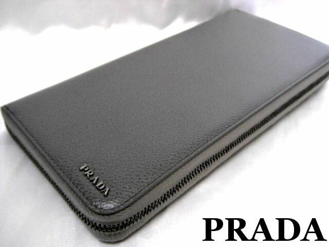 2d758d2b8355 プラダからクラッチバッグ感覚で持ち歩けるオーガナイザー長財布です。 立体的に配置した『PRADA』メタルロゴがさりげなくブランドを主張!