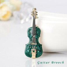 エレガントなグリーンのギターブローチ