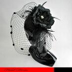 花芯に雄しべのついた細やかなコサージュのヘッドドレスです。☆ヘッドドレス/フラワー/コサージュ/フォーマルハット/パーティーハット/結婚式/フェザー/