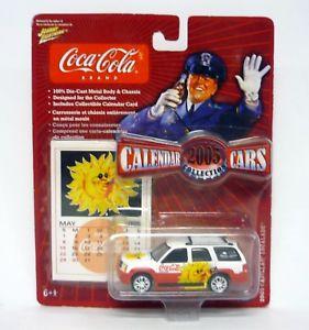 【送料無料】模型車 モデルカー スポーツカー johnny lightning 2003 cadillac escalade calendar cars diecast moc 2004