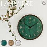 シンプルさを生かした腕時計のようなデザインの電波時計。木目を活かしたレトロな表情が魅力。L...