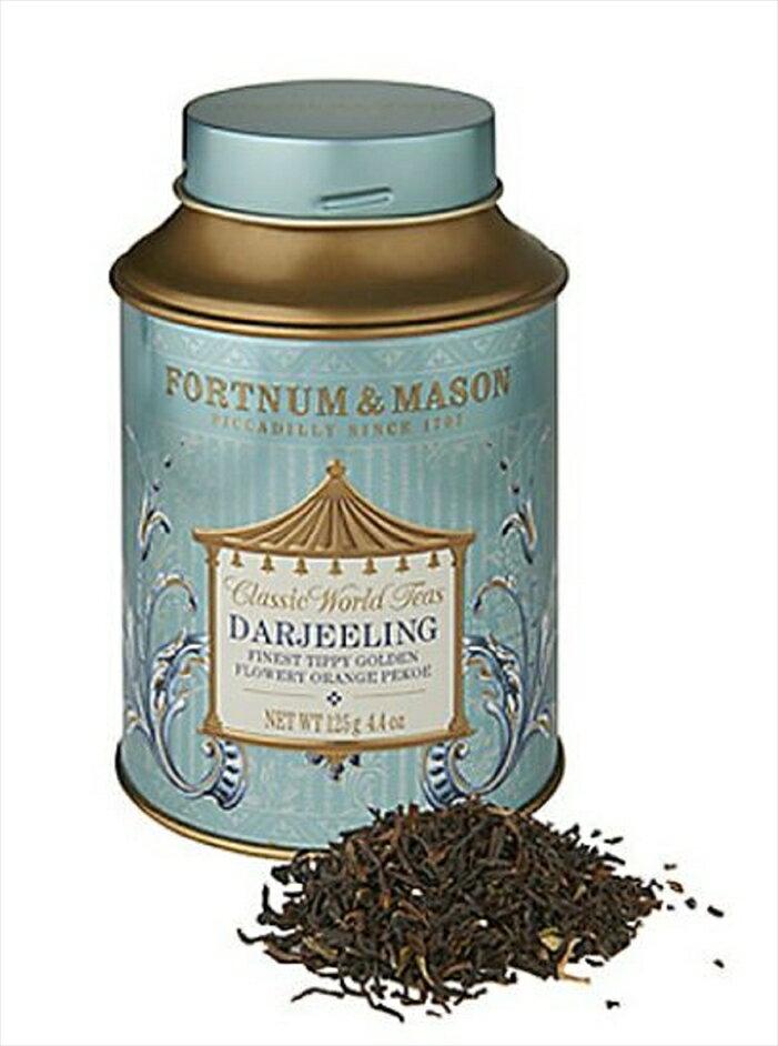紅茶の缶と茶葉