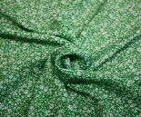 ポリエステル100%シフォンジョーゼット平織りグリーン地にオフホワイトの小っちゃい小花柄。日本製布生地布地服地通販緑ポリエステルシフォンジョーゼット