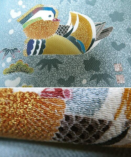 ■新品 お仕立上羽田登喜男 謹製まるまん 浜ちりめん手描き 九寸名古屋帯 水色「円取散らし松竹梅」