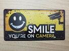 SMILEYOU'REONCAMERAレトロブリキ風看板(約30cmX15cm)笑って!防犯カメラ作動中!送料無料