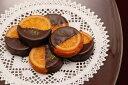 銀座スイーツ社長の発案から生まれたリキュール香るバレンシアオレンジとチョコレートの組合せガレッ…
