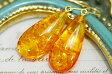 琥珀ピアス/イヤリング 黄金の花びらのようなグリッターきらめくしずく形