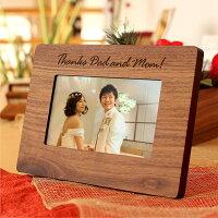 お二人の生い立ちや幸せな姿を写した写真を入れてご両親へのプレゼントに