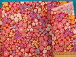 綿プリント生地小花/リボン・赤×ピンク