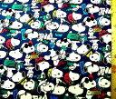 キャラクター 生地 布 スヌーピー ( モード 紺 ) 柄番号142 ( 2021 ) オックス( 綿100% ) 生地幅−約108cm ( ピーナッツ )