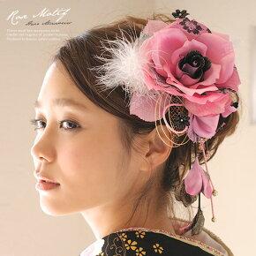 大きなピンク系のバラ髪飾り