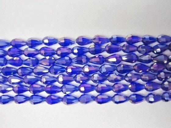 【半連売り商品】クリスタルガラスビーズブルー系ドロップ多面カット(縦穴)7×Φ4mm【表面加工タイプ】画像