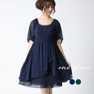 4f95a0dad2b40  結婚式 お呼ばれドレス 30代 Aラインワンピース ウエストを高めにとった切り替から斜めにふわりと流れるラッフルが、女性らしさを演出する愛されAライン  ...